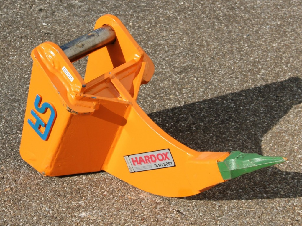 Ripping tooth equipped mini excavators